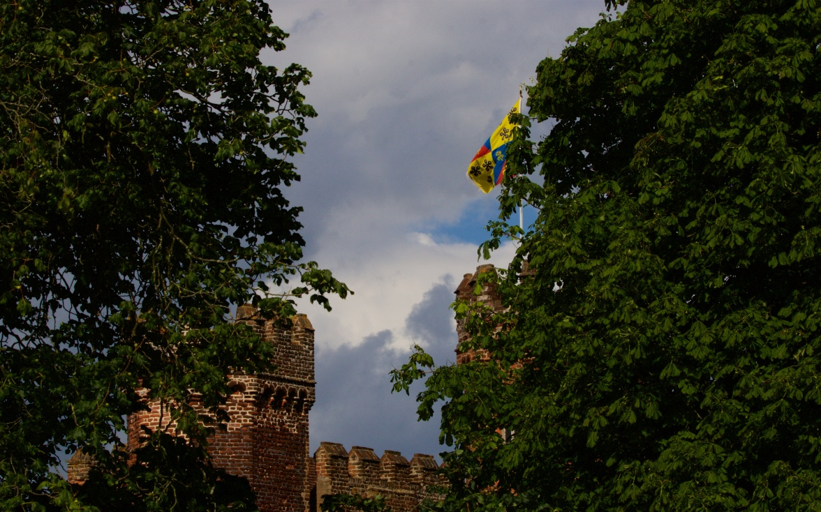 Lullingstone Castle with a guard of horse chestnut and lime trees
