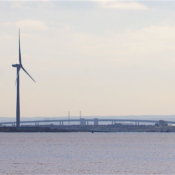 Wind turbine with the bridge over the Swale beyond