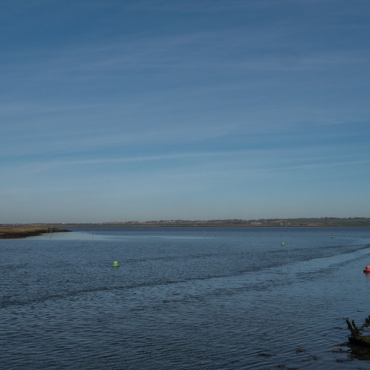 Yacht leaving Conyer creek on the flood tide for the Swale