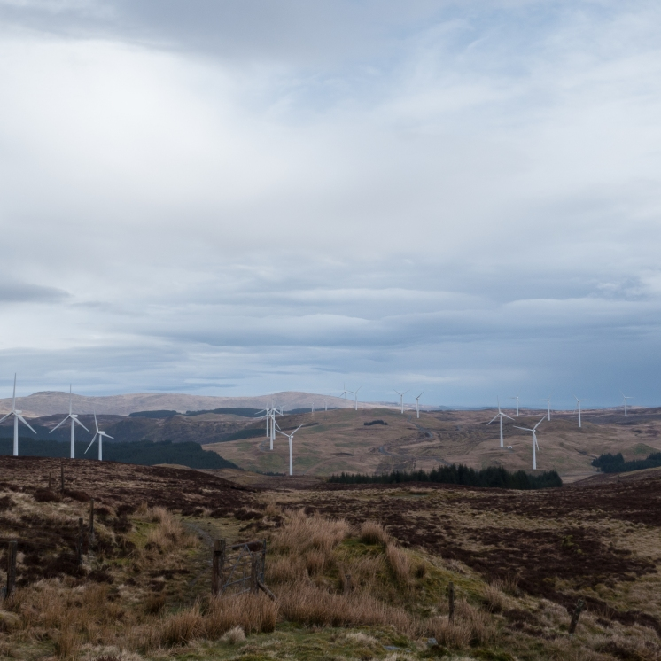 The cluttered view north - Cefn Croes wind farm and patches of Sitka forest